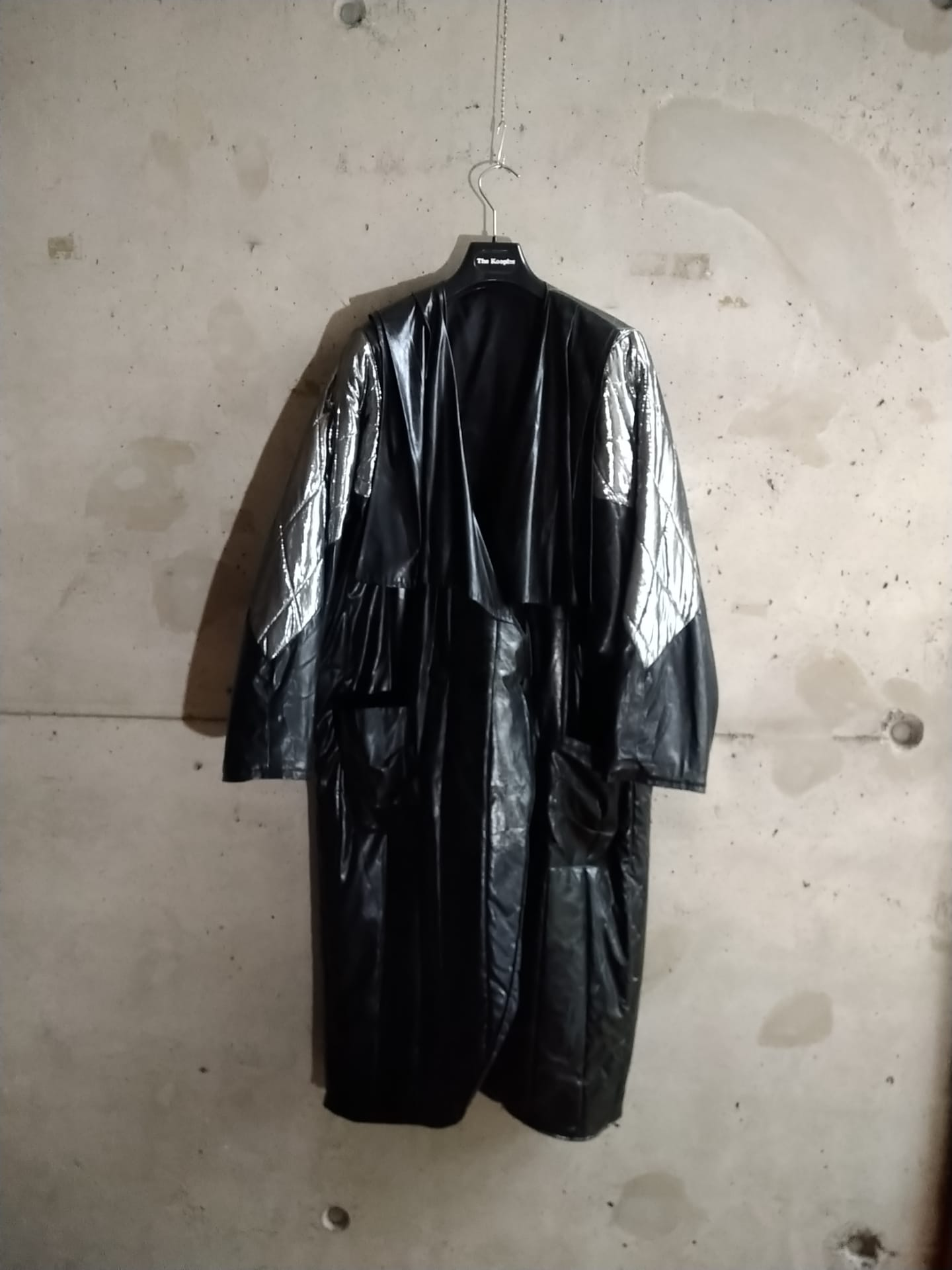 Black and silver vinyle coat