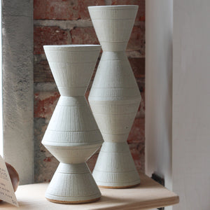 White Carved Vessels