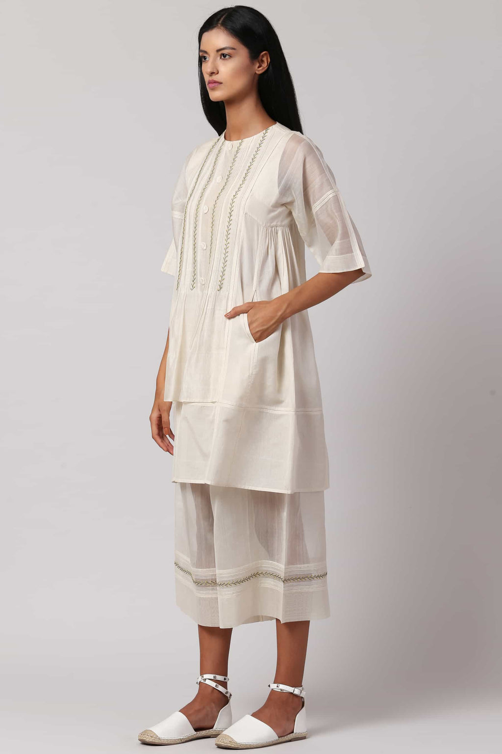 Ivory hand-embroidered dress made in 100% handwoven yarn dyed silk Chanderi - side