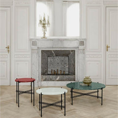 GUBI TS Coffee Tables by Gam Fratesi in room with fireplace