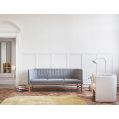 Ivory White Brass AJ7 Bellevue Floor Lamp in room with Arne Jacobsen Mayor Sofa and Loafer Chair &Tradition Copenhagen