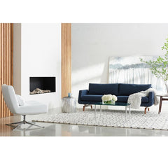 American Leather Nash Sofa Indigo Blue with Walnut Base in room with Swivel Chair