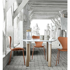 Analog Table in Room with Tal R Series 7 Chairs in Chevalier Orange Jaime Hayon Arne Jacobsen Fritz Hansen
