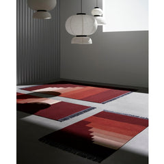 And Tradition Formakami Pendant lights by Jaime Hayon in room with rugs by All the Way to Paris