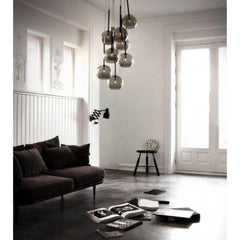 And Tradition SR6 Ice Chandelier Black Lustre in room with Space Copenhagen Fly Sofa