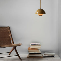 Verner Panton VP1 Pendant Light Mustard Yellow in room with chair and books