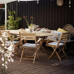 Selandia Armchairs with Cushions and Dining Table by Skagerak