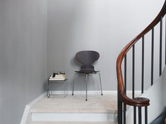 Ant Chair Three Legs Styled in Room with Stairway Fritz Hansen Arne Jacobsen