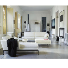 Antonio Citterio Suita Sofa Ottoman Chaise in Room with Hocker Stools Vitra