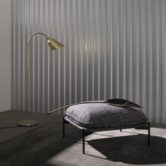 Arne Jacobsen Brass Bellevue Floor Lamp in Room with Luca Nichetto Cloud Ottoman And Tradition