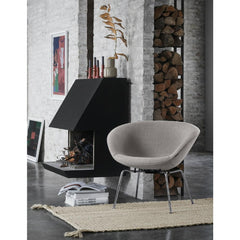 Arne Jacobsen Pot Chair by Fritz Hansen in Light Warm Grey in room with Art and Firewood