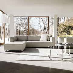 Barber Osgerby Asymmetric Sofa and Ottoman in Room with Breuer Laccio Coffee Tables