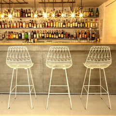 Bend Lucy Barstools in White at Bar