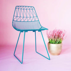 Bend Lucy Chair Teal with Pink Plant