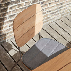 Lilium Teak Dining Chair with Charcoal Cushion by Bjarke Ingels Group for Skagerak
