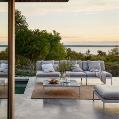 Skargaarden Bönan Lounge Sofa, Ottoman, and Large Table with Dark Grey Limestone Top poolside