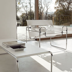 Marcel Breuer white laccio coffee table in room with white Wassily chair Knoll