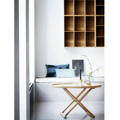 Mogens Koch Bookcase wall mounted in room with tray table
