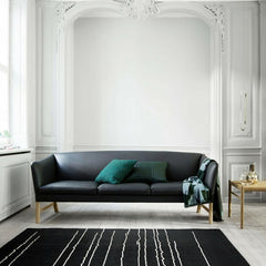Carl Hansen and Son Ole Wanscher Sofa OW603 in room with Woodlines Rug