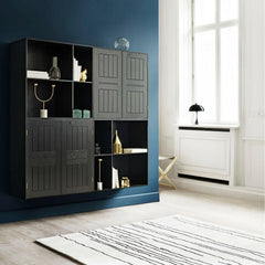 Carl Hansen and Son Mogens Koch Cabinets and Shelving Black Painted Oak in room with Woodlines Rug