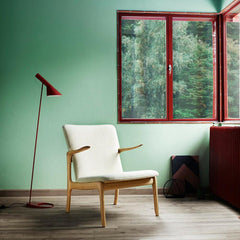 Carl Hansen and Son Ole Wanscher Beak chair in room with Arne Jacobsen Lamp