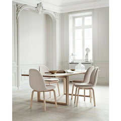 Cecilie Manz Essay Table in room with Sammen Chairs Jaime Hayon Fritz Hansen