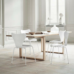 Cecilie Manz Essay Table in room with white Series 7 Chairs Arne Jacobsen Fritz Hansen
