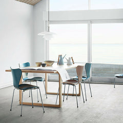 Cecilie Manz Essay Table in Room with Colored Series 7 Chairs