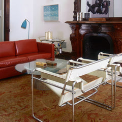 Red Leather Pfister Sofa in room with Ivory Leather Wassily Chairs Knoll