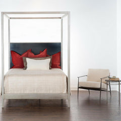 Charleston Forge Sloan Canopy Bed in room with Emmitt Lounge Chair
