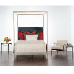 Charleston Forge Sloan Canopy Bed in Room with Collins side tables and Emmitt Lounge Chair