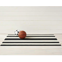 Chilewich Bold Stripe Doormat Black and White with Kid's Soccer ball and Basketball