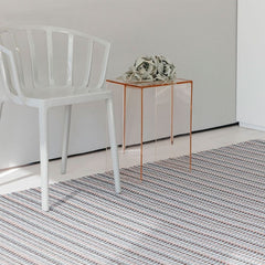 Chilewich Heddle Floormat Dogwood in room with Kartell Venice Chair