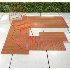 Chilewich Skinny Stripe Rug Outdoors with Bend Lucy Chair in Orange