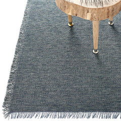 Chilewich Pacific Market Fringe Woven Floor Mat with Wood Table