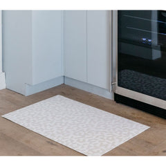 Chilewich Prism Floor Mat Natural in kitchen with wine refrigerator