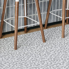 Chilewich Prism Floor Mat Silver in room with bar stools