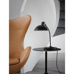 Christian Dell Kaiser Idell Tillable Tablelamp Matte Black with Arne Jacobsen Egg Chair and Kasper Salto Little Friend Fritz Hansen