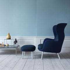 Dark Blue Ro Chair in Profile in Room with Poul Kjaerholm Coffee Table
