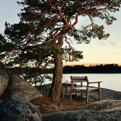 Djurö Lounge Chair with Batyline Seat and Backrest with Djurö Sidetable and Marstrand Candle Lantern by Skargaarden