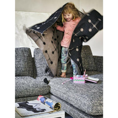 Vitra Eames Wool Dot Pattern Blanket with Girl on Suita Sofa