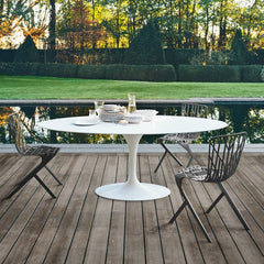 Eero Saarinen Oval Dining Table Vetro Bianco Outdoors with David Adjaye Chairs Knoll
