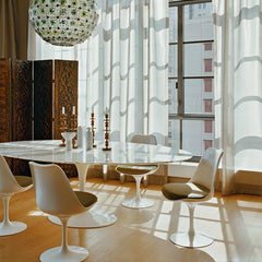 Eero Saarinen Tulip Dining Chairs in Room Knoll