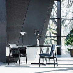 EOOS EO04 and EO05 Dining Chairs in Room with Black Embrace Dining Table