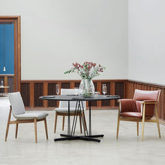 EOOS EO04 and EO05 Embrace Dining Chairs in room with Embrace dining table Carl Hansen and Son