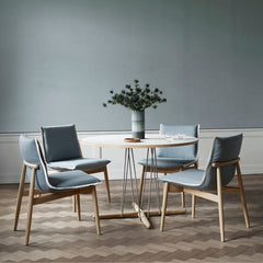 EOOS EO04 Embrace Dining Chairs in room with Embrace dining table and flowers Cal Hansen