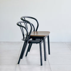 ercol flow chairs by tomoko azumi stacked in walnut and black