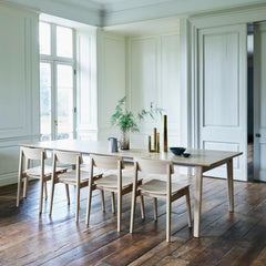 ercol Forma dining chairs in room with Ponte dining table