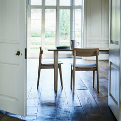 ercol Forma dining chairs in room through doors with Ponte dining table