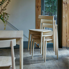 ercol Lara Chairs in Ash stacked beside Luca Table